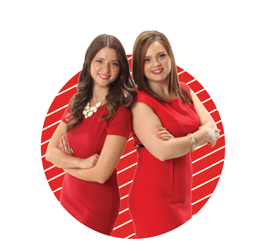 Patricia and Brenda Boral in red dresses smiling and standing shoulder to shoulder with arms crossed.