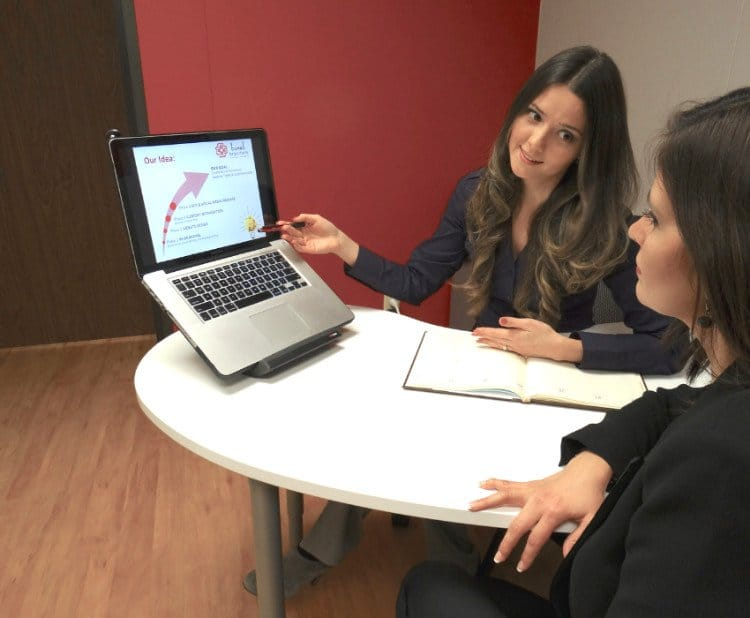 Patricia Boral helping three clients with digital marketing strategy in one-day workshop.