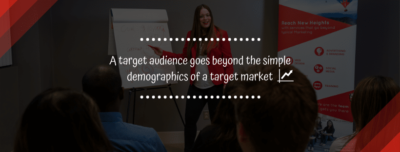 B2B Branding - A woman standing in front of a small crowd, pointing to a presentation paper